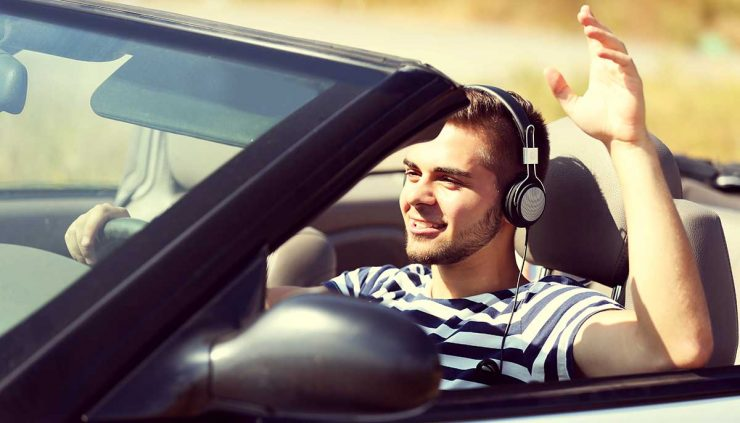 man driving with headphones